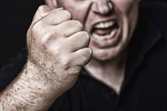 Man with his fist raised - New York Assault Attorney